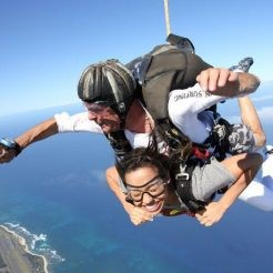 Two people skydiving on the North Shore, Oahu, Hawaii