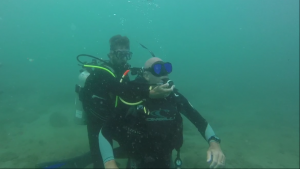 Divemaster learning emergency preparedness and life saving skills at the PADI rescue diver course