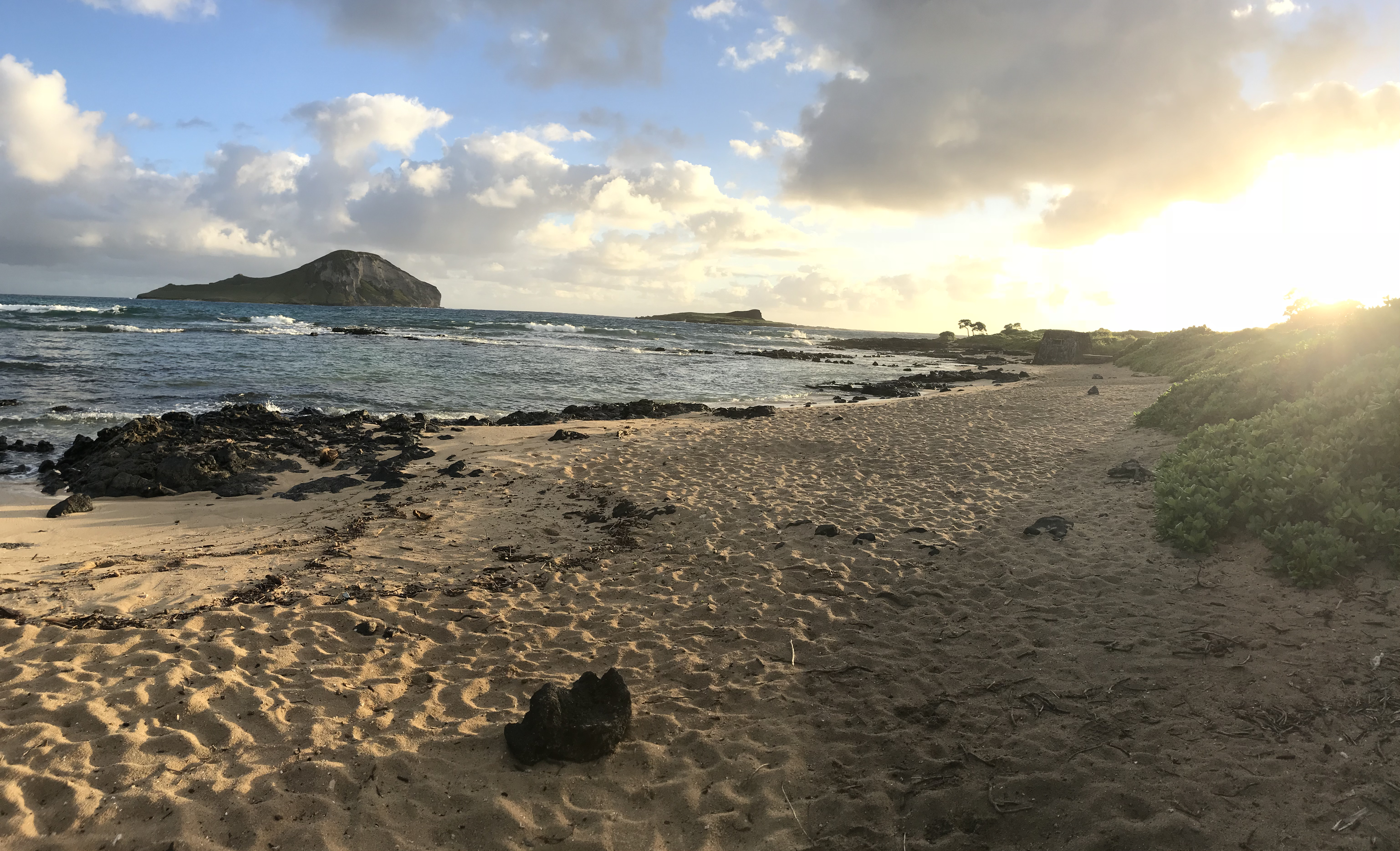 Baby Makapuu Tidepools with the sun rising, taken before the beach clean up started