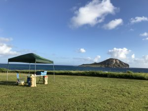 A tent with supplies set up at Baby Makapuu Beach Park
