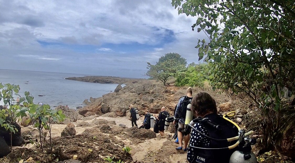PADI Rescue Divers in training take the trail down to Shark's Cove to complete their final day of training.